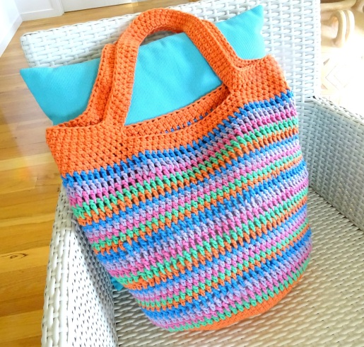 Crochet Bag Large Slouch Colourful Stripe On Chair with Angle Landscape
